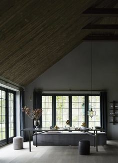 Dark windows provide a beautiful contract agains the pale tones of the walls and wood flooring. Our coastal, white mist or driftwood wooden floors would compliment these colours beautifully! Interior Barn Doors, Interior And Exterior, Interior Design, Coastal Living Rooms, Living Spaces, Grey Window Frames, Mad About The House, Grey Walls, Dark Walls