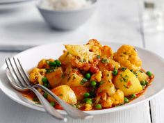 Cauliflower, Potato, and Pea Curry | Our version of this curry, a favorite combination of vegetables in India, unites cumin, coriander, turmeric, and red-pepper flakes. Fresh cilantro pro...