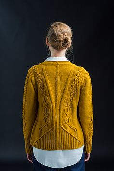 Ornately cabled and beautifully tailored, this cardigan inspired by Tyrolean jackets invites a full spectrum of styling choices. Medallion cables climb the fronts, sleeves, and back at a diminishing scale, eventually twining into an ornate braid that takes full advantage of Arbor's excellent stitch definition. German short rows, transitions in background fabric, and traveling columns of ribbing create flattering lines and a precise fit. Twisted-rib button bands perfected with a picot…