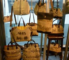 Tamara Fogle is making handbags using antique german flour sacks from 1830 to 1930. They have the original marks and stains and holes in them. Some are repaired and you can see the stitching. They look so soft and comfortable and broken-in already. The black writing,which is different on every sack, has the farmers' name, and in some cases, the date the sack was made.