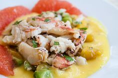 Crab mango salad recipe with avocado.  Dungeness crab lump meat gently folded with cilantro, lime, avocado and mango.  Served with a citrus mango sauce.