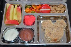 honeycrisp apples, yogurt, applesauce, mickey sandwich, chocolate chip goldfish, babybel cheese, rainbow goldfish & heart marshmallow