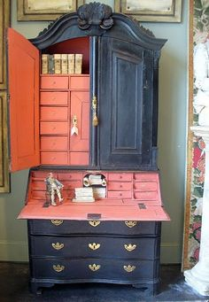 I love the salmon-ey pink inside...thinking I should paint the inside of my built in hutch this color.