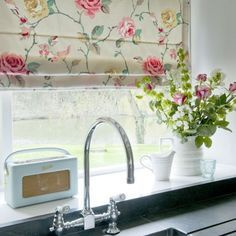 How cute is this vintage inspired kitchen with a floral blind, retro radio and bunch of fresh wild flowers?