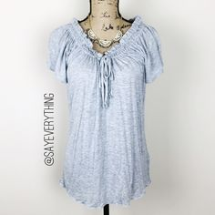 """GAP Gathered Tie Neckline Tee Super soft and comfortable t-shirt by the GAP. Light heather gray color. Gathered neckline with a drawstring to adjust. Size M. Bust is 19"""" across and length is 25."""" Rayon that is a smooth soft texture. Excellent condition. Thanks for looking! GAP Tops Tees - Short Sleeve"""