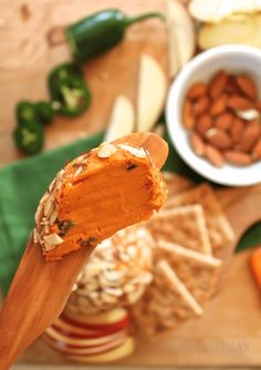 A sweet and spicy buffalo vegan cheddar cheese ball rolled in smoky coconut bacon and seasoned with hot buffalo sauce. Perfect for game day. Vegan Cheddar Cheese, Vegan Cheese Recipes, Dairy Free Cheese, Raw Food Recipes, Nut Cheese, Cashew Cheese, Smoked Jalapeno, Jalapeno Cheddar, Smoked Paprika