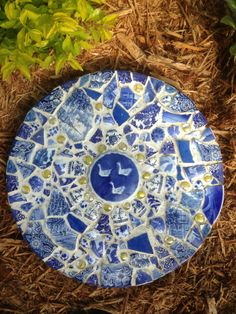My broken blue plates put to use. I used a tile glue to a concrete stepping stone and outdoor tile grout.