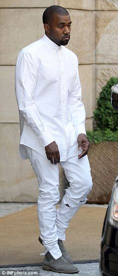 Kanye West at Ploskovice Castle in the Czech Republic on May 31, 2014. Love his white ripped pants.