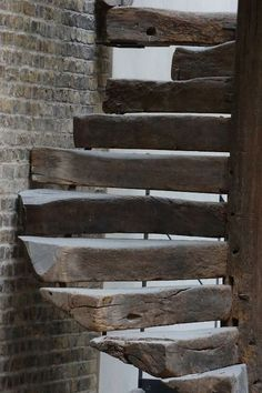 STAIRCASE – one of the most unique circular staircases I've ever seen. Very rustic, open, and custom.