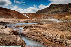 Heat rises from the ground at the Seltún Geothermal Pools, Iceland