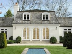 Love the symmetry Round Hill Serenity, Greenwich CT Single Family Home - Greenwich Real Estate Roof Design, Exterior Design, House Design, Tudor House, Houses Architecture, Architecture Details, Porches, French Exterior, Mansard Roof