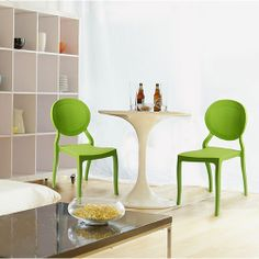 Vanessa Dining Chair - Easy to clean polypropylene, suitable for outdoor use, and stackable. $318 for a set of two.