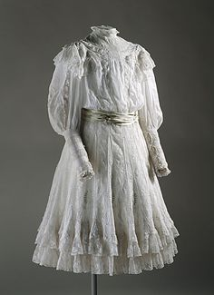 An extremely delicate girl's cotton lawn dress made in England, circa 1900.