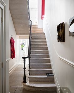 Traditional Hallway with Stone Staircase and Curving Banister - The Room Edit