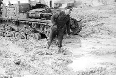 Italian tank ( probably a Semovente 75/34 self propeled gun ) stuck in the mud. Italy.1944.