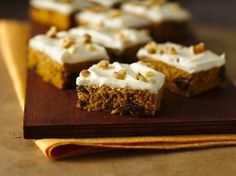 Gluten Free Harvest Pumpkin Spice Bars. You'll fall in love with these pumpkin bars! They have a light texture, are full of cinnamon, ginger, raisins and nuts, and are topped with cream cheese frosting.