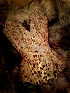 Sugared Leopard corset by Sparklewren.     Rose quartz, freshwater pearls, silver spikes, pink lace, and purple silk beneath... Then claret-gold lace on top of leopard silk satin... I wanted to bring down the hard sparkle of the Gilded Leopard corset and create a softer lustre for Springtime. www.sparklewren.co.uk