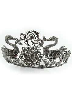 Every woman at least once in her life deserves to wear a crown. Why not wear our fabulous Silver Opera Tiara? It's the perfect addition to our Black Swan or princess costume. Or use it to celebrate your birthday or bachelorette party.