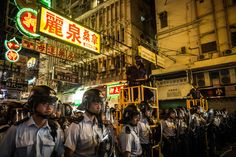Police officers clashed with pro-democracy demonstrators in Hong Kong's Mong Kok district. (Photo: Chris McGrath/Getty Images)