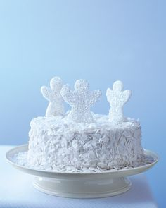 Snow angels make an appearance on the dessert table with a light-as-air angel food cake covered with drifts of fluffy coconut and topped with angel-shaped lollipops.