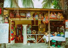 """For the best souvenirs in Jaco, Costa Rica hit up this spot: """"Manuel Antonio's streets are tipping with kiosks and shops that reek of all things souvenir. From bags and stuffed sloths to bracelets and woodwork, you'll find what you're looking for (and probably something you aren't!)."""" (Kylie Turley)"""