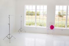 inside real studios: tara swain photography This is my dream studio…. White everything with splashes of color.