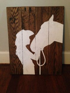 All paint no vinyl, on pallet wood White silhouette on Dark walnut wood 14 in across x 24 in tall Approx *Please note each piece will differ due to each piece having its own character * thats what makes it unique Arte Pallet, Pallet Art, Western Crafts, Western Decor, Cowboy Home Decor, Horse Crafts, Wood Crafts, Wood Projects, Woodworking Projects