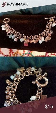 Shoppers Bracelet! Very full and pretty charm bracelet with shopping charms like a shoe, a purse, a bag, and even a credit card. Great gift for a fellow posher! Cutest enclosure with the bone going through the circle Jewelry Bracelets