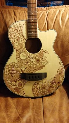This is a custom acoustic bass guitar that I built from a kit. The top is basswood. I added the henna style design to the top with brown sharpies . Ukulele Art, Acoustic Bass Guitar, Custom Bass Guitar, Custom Guitars, Cello, Ukulele Design, Bass Guitar Lessons, Henna Style, Guitar Tattoo