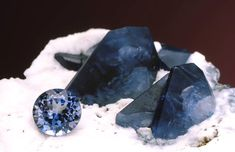 Faceted and Natural Benitoite, State Gemstone of California.   Benitoite occurs in gem quality at only one place in the world, a mine in the Diablo Range of San Benito County, California. This unique wreath-like intergrowth is one of the finest known specimens of the gem.