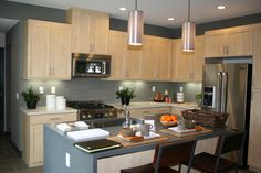 This kitchen shows off a mix of classic and modern design and uses Caesarstone on the countertops to finish the look off beautifully!