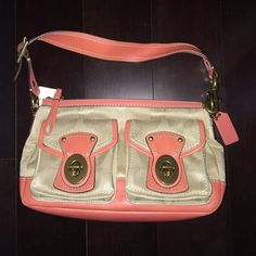 NWT Coach Legacy Nylon Signature Shoulder Bag HAPPY HOLIDAYS. Brand new ..... Never used Coach Legacy Khaki/Coral satchel (shoulder bag). Comes from a smoke free home. Accepting reasonable offers. Thank you all for looking. Coach Bags Shoulder Bags