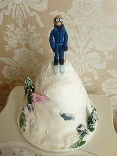 Skiing themed novelty cake