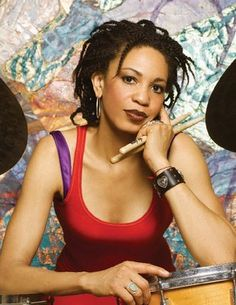 Drummer, Cindy Blackman Santana, 54/ there is a video on youtube of her in concert with her husband Carlos Santana. She is one bad-ass amazing drummer & pretty too.