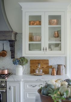 """I also added a few copper pieces to my normally all white cabinets. I love the way they carry the warm fall tones throughout my kitchen. Overall, my kitchen definitely says """"fall"""" without being overly decorated for the season and that's just the way I like it! Glass Kitchen Cabinets, Kitchen Cabinet Design, Interior Design Kitchen, Kitchen Countertops, Kitchen Decor, Marble Countertops, Decorating Kitchen, White Cabinets, Bathroom Interior"""