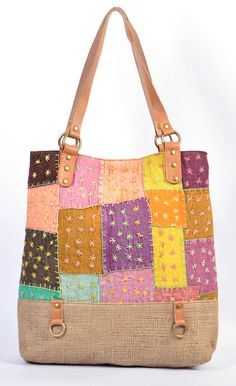 Handmade Jute Plus PatchWork Shopping Bag .Multi colored  patches jut base bag with geniuene leather handle desgn. All the elements which go into making a quality product is monitored right from the first stage of leather selection to finishing of the product at their manufacturing facility. #handbag #purse #Ahmedabad  #handmade #Designerbags #bags #styleincraft #leatherbags #tabletbag #clutches #flapbag #largepouch