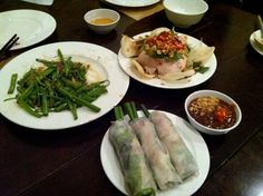 more dishes of dinner at nha hang ngon.  vietnamese cold spring rolls, fried shoots and thick peanut dipping sauce.  (ho chi minh, vietnam, southeast asia)
