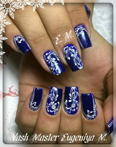 Nail Enamel Blue Acrylic with white spiral designs.