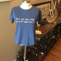 Sz medium short sleeve T with running graphic This WOMENS top is a sz medium and reads, does this shirt make my butt look fast. One more mile Tops Tees - Short Sleeve