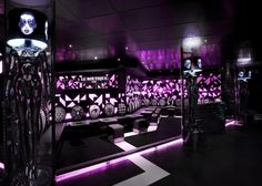 black lacquered mannequin shaped lamps give le boutique club a retail feel photo - Nightclub Design Ideas