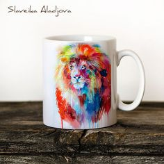 Lion Mug Watercolor Ceramic Mug Unique Gift Coffee Mug Animal Mug Tea Cup Art Illustration Cool Kitchen Art Printed mug ABOUT MY MUGS High quality ceramic mug Microwave and dishwasher safe Can be used for both hot & cold beverages Design shown on 11oz mug Heat-pressed by hand, using HD sublimation inks Portrait illustrations are printed 3 times on the mug Landscape illustrations are printed 2 times on the mug SHIPPING INFORMATION Please allow up to 1-2 business days for production of ...
