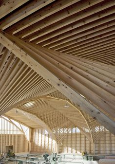 JA+U : Remarkable Japanese Timber Structures / Fumiko Misawa + Masahiro Inayama - Kitazawa Kenchiku Factory: The 18 meter-wide (59 feet) span over this timber mill is necessary for moving 6 meter-long (19.7 feet) logs. The roof is supported by a unique system of trusses which interconnect, forming a dramatic three-dimensional effect.