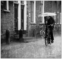 'Cycling Through the Rain' Groningen, the Netherlands.the smile on this guy's face is why I love the rain. Cozy Rainy Day, Rainy Night, Walking In The Rain, Singing In The Rain, Its Raining Its Pouring, Holland, Arte Black, Smell Of Rain, I Love Rain