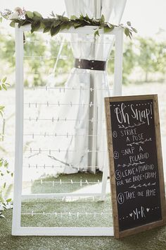 less wordage on sign more old fashioned frame leave a few photos up before guests arrive leave props -movie props Wedding Games, Wedding Signs, Wedding Table, Rustic Wedding, Wedding Venues, Wedding Planning, Wedding Guest Activities, Wedding Parties, Wedding Photo Walls