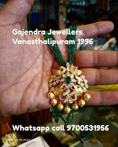 Stunning emeralds long haaram with dancing peacock pendant. Pendant with gold ball hangings. Pearl Necklace Designs, Gold Earrings Designs, Beaded Jewelry Designs, Gold Necklace, Pearl Jewelry, Indian Jewelry, Gold Bangles Design, Gold Jewellery Design, Gold Pendent