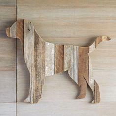 "RECLAIMED RETRIEVER -- Still sporting bits of original paint, reclaimed wood from demolished barns gets new life in our folk art friend. Realistically sized, each retriever has individual character, just as in real life. Handcrafted in USA. Catalog exclusive. 32""W x 1-1/2""D x 26-1/2""H."