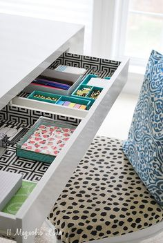 Desk drawers don't have to be boring! Line them with shelf paper {this desk came with the greek key lining already from @homegoods } and add some small drawer organizers, some pretty stationery and some gold clips and suddenly working will be MUCH more fun :) Sponsored Pin.