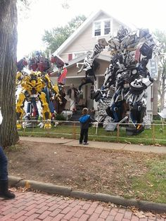 Halloween decorations in my neighborhood. This guy makes these by hand and puts them up every year - Imgur
