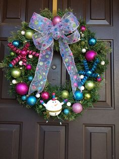 Beautiful Christmas Wreath pink, bright turquoise, lime green and snowman ornaments on artificial wreath lights up on Etsy, $55.00