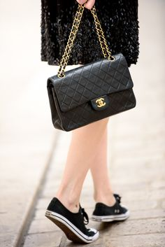 Chanel and black Converse sneakers
